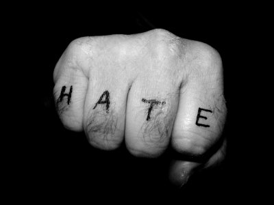 white_fist_with_hate_written_across